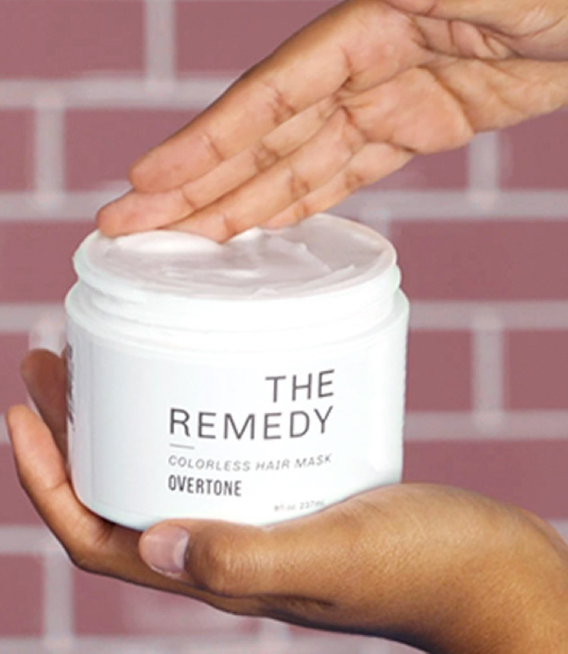 hand grabbing some Remedy Colorless Hair Mask