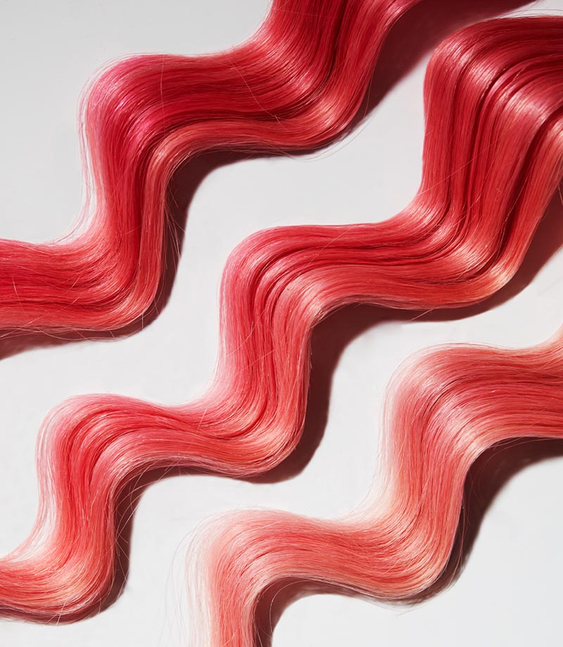 three strands showing how color fades using the Fader Clairfying Shampoo
