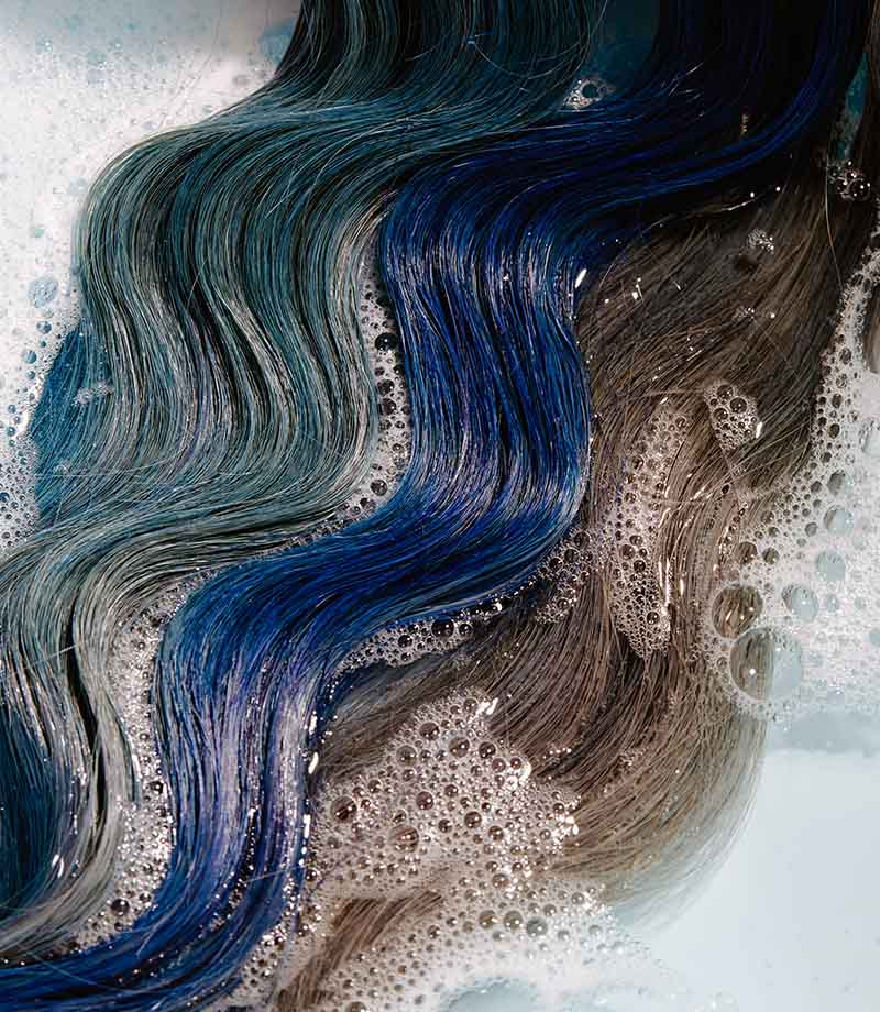 varying shades of blue hair in soapy water